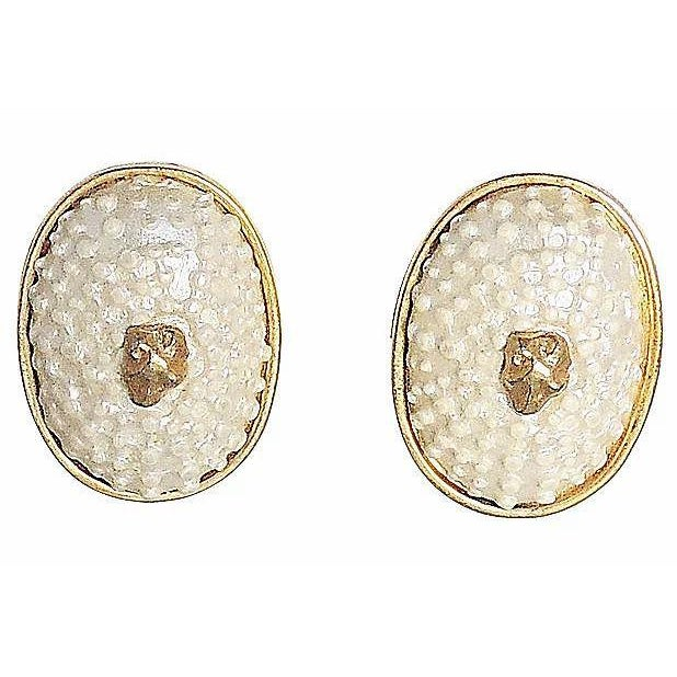 """1980s goldtone and white resin faux-shell with small animal head center clip back earrings. Marked """"Valentino."""" Condition:..."""