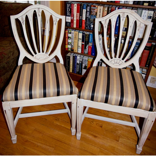 Circa 1940's! Beautiful pair of accent chairs with an ivory chalk paint finish. All original details are highlighted with...