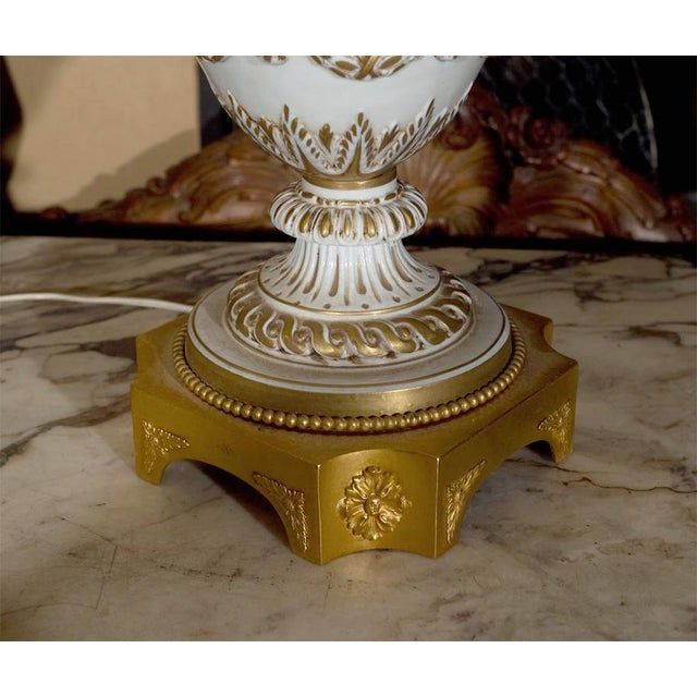 White Ornate White Ceramic Lamps on Bronze Base - A Pair For Sale - Image 8 of 9