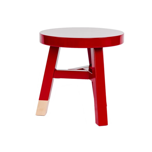 Merchant Common Comrade Side Table By Moooi These red lacquered solid birch side tables from Moooi are a clever...