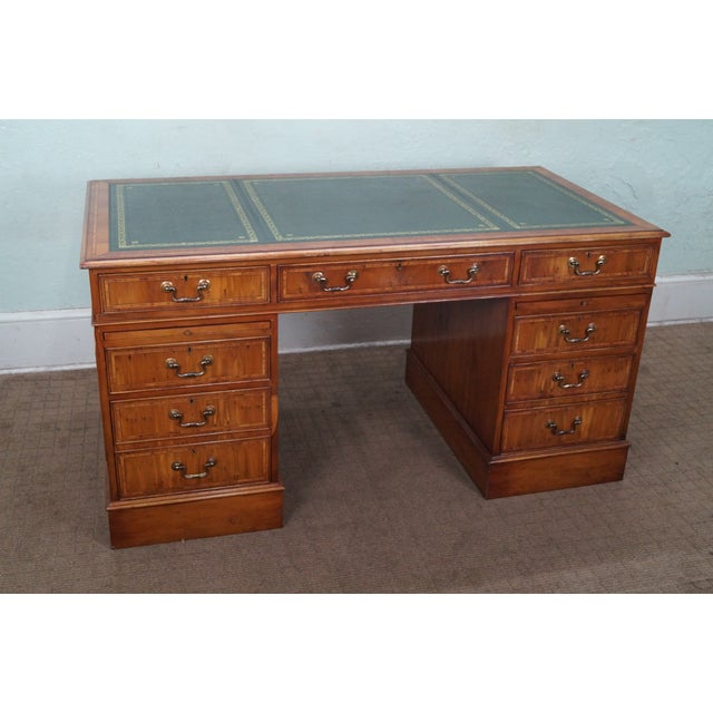 Store Item #: 8970 Quality English yew wood leather top executive writing desk. Approx 30 years, England. High quality,...