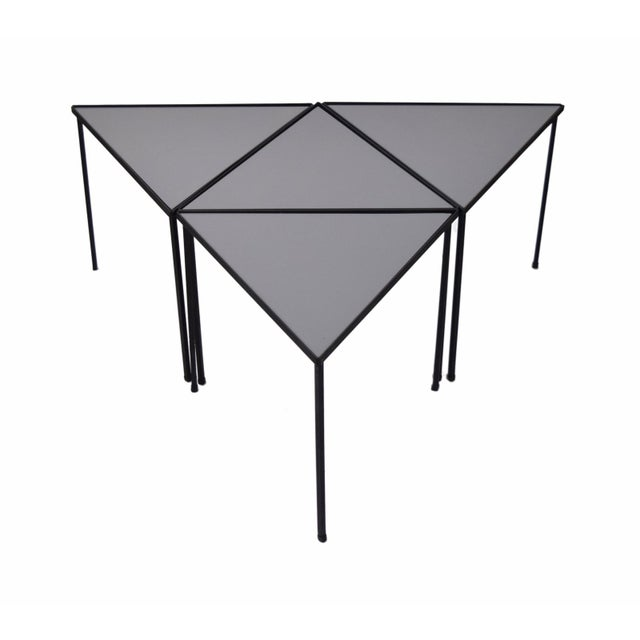 Fabulous set of four triangle side tables. Steel frames with opaque gray glass inserts. So versatile and handy, can be...