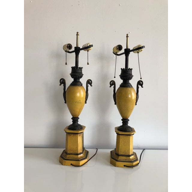 Pair of vintage yellow Italian urn tole Lamps with black European Landscape scenes. Aged black painted details and crackle...