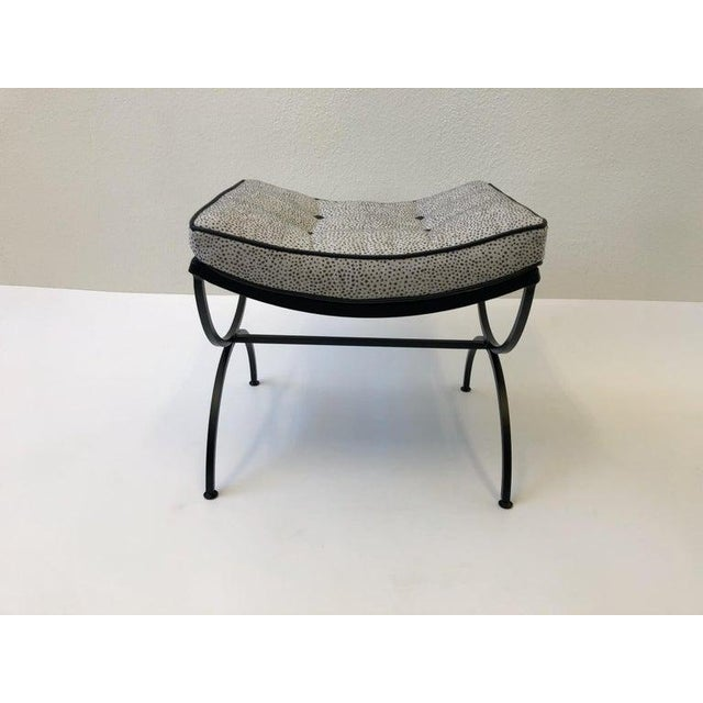 """A pair of 1960s black powder coated steel """"Sculptura"""" ottomans by Woodard. The ottoman have been newly powder coated flat..."""