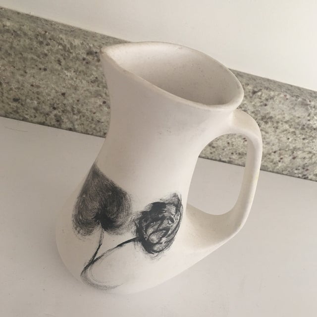 A lovely, small, hand painted French ceramic pitcher purchased in the Marquis, Paris. The small size is perfect for milk...