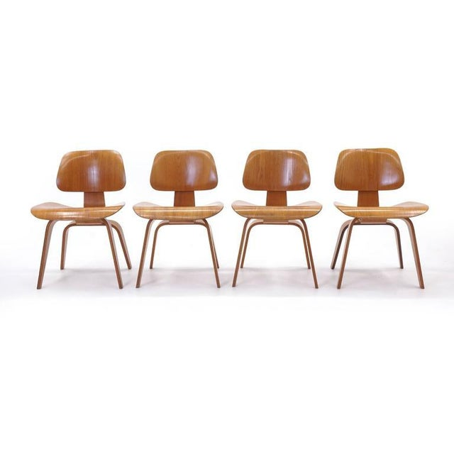 Beautiful set of four early original Eames dining chairs for Herman Miller. See our listing for a pair of red aniline dyed...