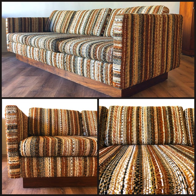By Scandiline of Norway. Imported to US. Walnut base and woven upholstery. Color reads and various hues of brown, umber,...