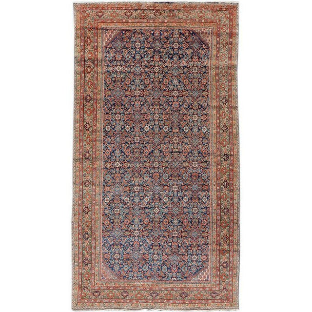 Using a delicate rendering of the repeat 'Herati' pattern, this Fereghan carpet from central Persia paints an elegant...
