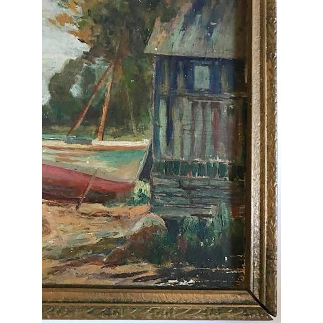 Vintage landscape painting. Shoreline with sailboats. Painting is on wooden board.