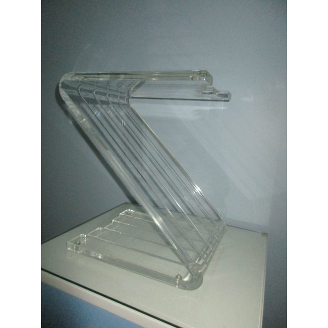 Here's a classic Z shaped Lucite side table. The flat, molded and sculpted acrylic is .75 inches in thickness. The z shape...