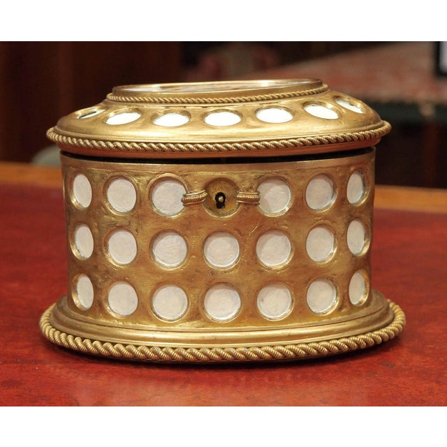 A 19th century porcelain jewelry box with bronze mounts and a mosaic top. Trimmed in a gilt bronze rope. Interior...