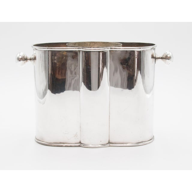 A fabulous early 20th-Century French Art Deco silver plated champagne ice bucket or wine cooler with round knob handles....