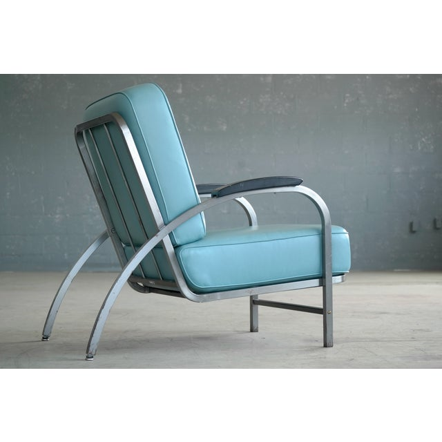Flat Iron lounge chair - 1930s inspired. Featured here is the Flatiron Lounge Chair in brushed, cold-rolled steel, named...
