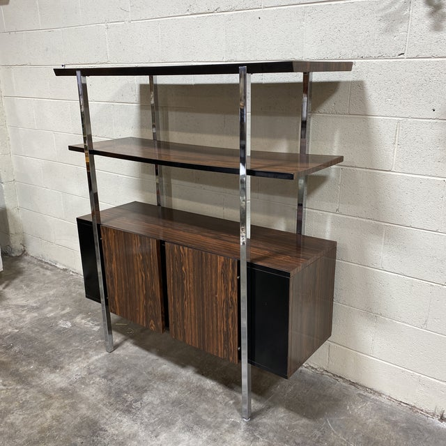 Very cool mid century piece likely from the 70s. Faux wood gloss laminate shelving and cabinet for storage. Laminate has a...