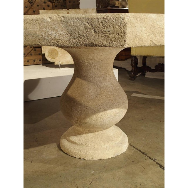 This versatile, hand carved, octogonal stone table from France can be used outside as well as inside. It is made of French...
