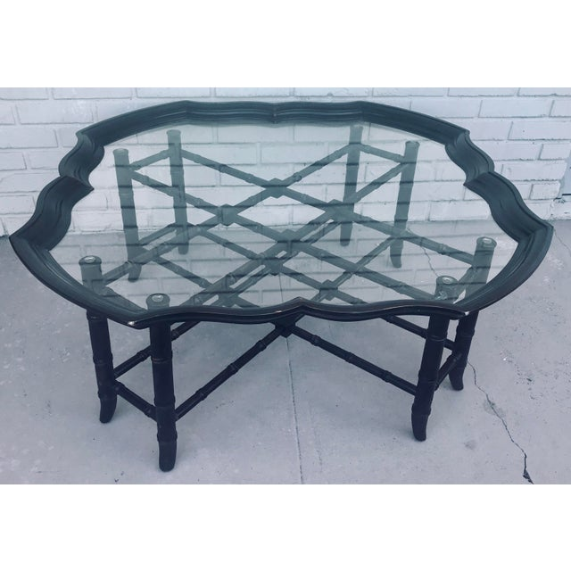 Stunning faux bamboo coffee table with detachable glass tray top. Made in the 1960s.