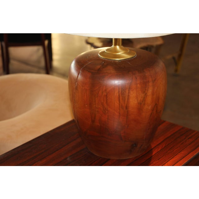 An extremely heavy turned wood base turned into a lamp. Nice patina to the wood and great cracking and character to the...