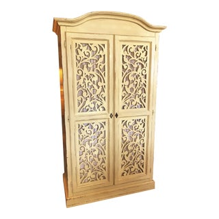 Late 20th Century Armoire With Carved Birds and Scroll Designs For Sale