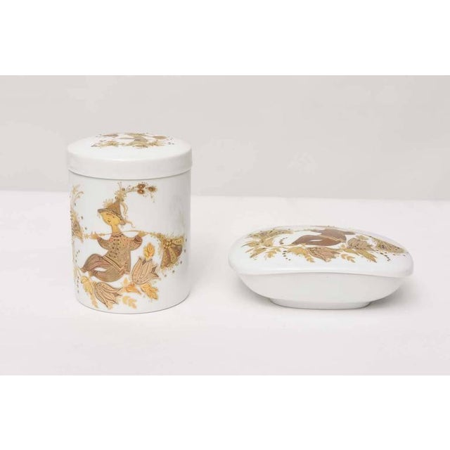 """""""Romance"""" pattern lidded canister and box by Bjorn Wiinblad. White porcelain with 24-karat gold decoration on front, back,..."""