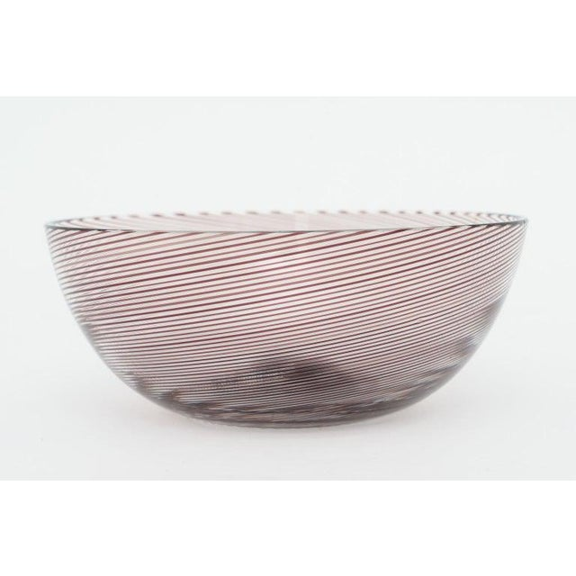 This stylish Venini Murano glass bowl is signed on the verso (see images) and dates to 1982. The swirls have a root beer-...