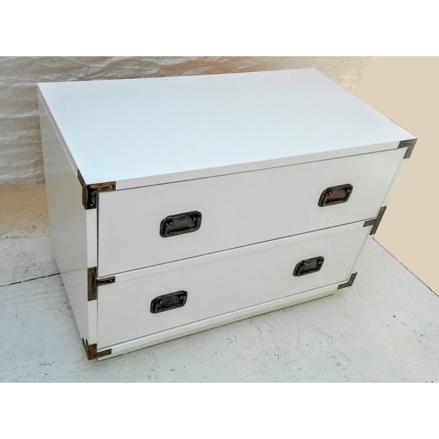 This beautifully refinished, vintage campaign dresser features a brilliant, smooth white finish. Embellished with four...