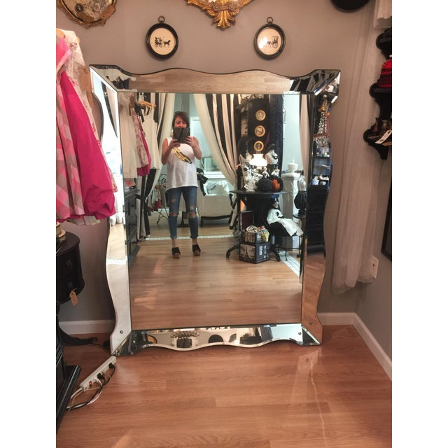 Beautiful, large Venetian style mirror with scalloped edge. Side panels separated by chrome corner beads. Glass seems to...