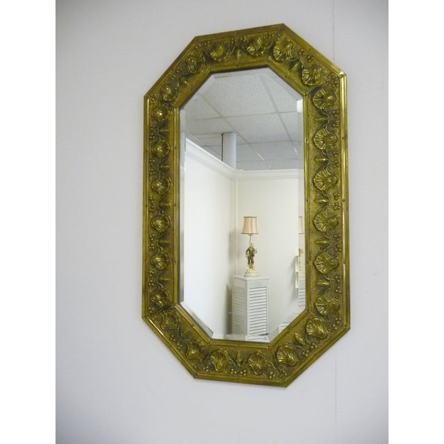 Antique European mirror - repousse' brass shell design with beveled glass mirror. Can be hung vertical as shown or...