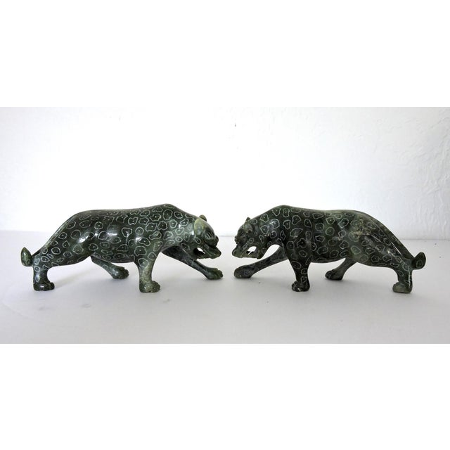 Vintage pair of Jadeite leopards on the prowl for a new home. Hand made in China with finely incised detailing of white...