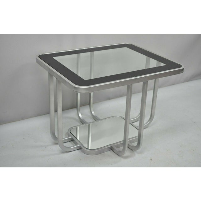 Vintage mid century modern art deco style 2 tiered metal & glass side table. Matching coffee table available in separate...