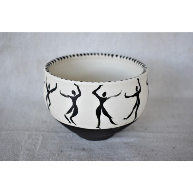 Black and white matte vase depicting dancing figures. Glazed on the inside. This is a pre-owned item so please see all...