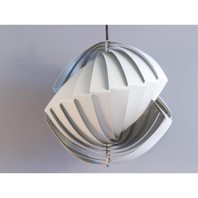 """Scarce, elegant, hanging pendant light by Louis Weisdorf for Lyfa. Danish for """"conch,"""" the Konkylie follows the shell's..."""