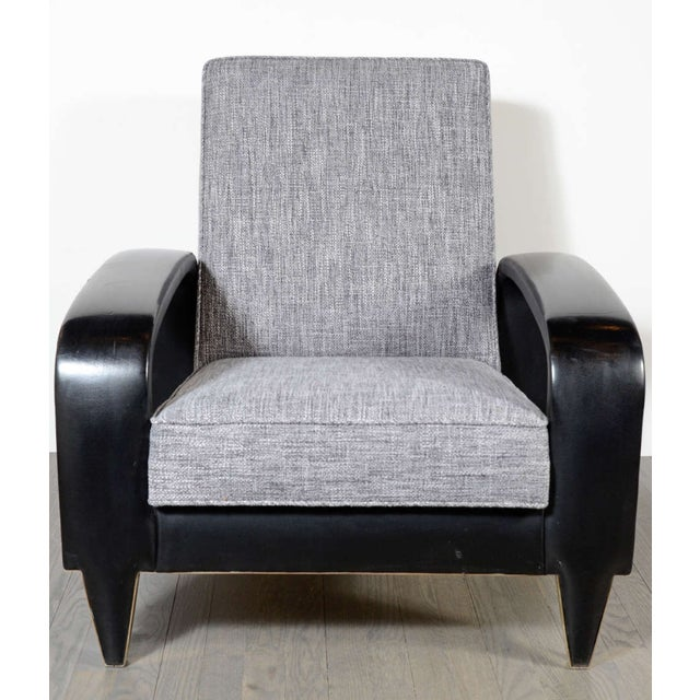 This rare Art Deco club chair, which comes from an Italian cruise liner, features sculptural banded upholstered leather...