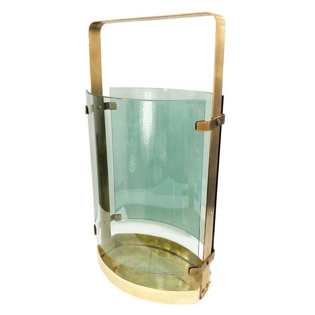 Beautiful 1960's umbrella stand by Fontana Arte with a brass frame and two curved acqua colored glasses.