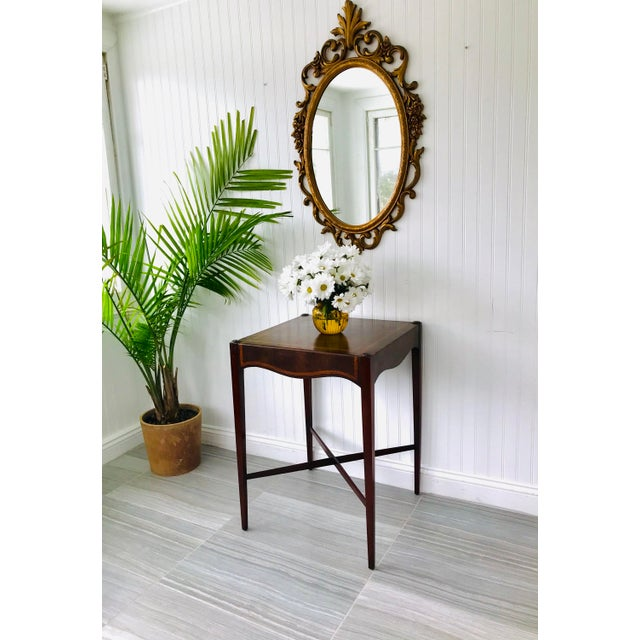 A table of exceptional quality, featuring solid mahogany construction and a rich leather top with a gold leaf border. Its'...