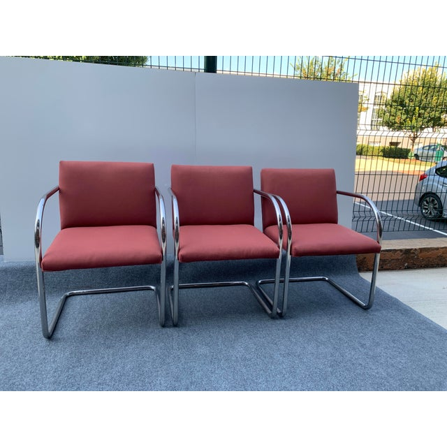 Three 1970s Vintage chrome cantilever arm chairs attributed to Ludwig Mies Van Der Rohe for Thonet. Gleaming tubular...