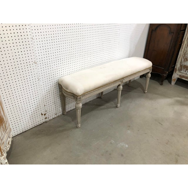 Extremely ornate stunning long bench imported from france. Solid Oak wood finished in a distressed gray covered in white...