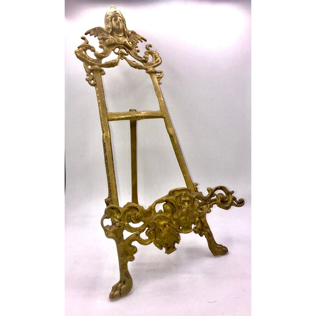 This ornate brass book stand or easel was most likely designed to hold a Bible. However it is perfect for showcasing a...