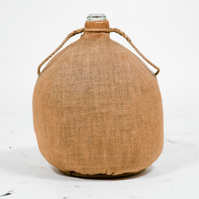 These scarce bottles were wrapped in burlap and cushioned in grass and dried flowers. They were used to store and ship...