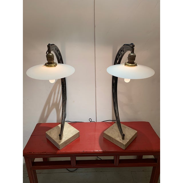 Extraordinary one of a kind pair of custom industrial table lamps having crescent shaped sculptural bodies constructed...