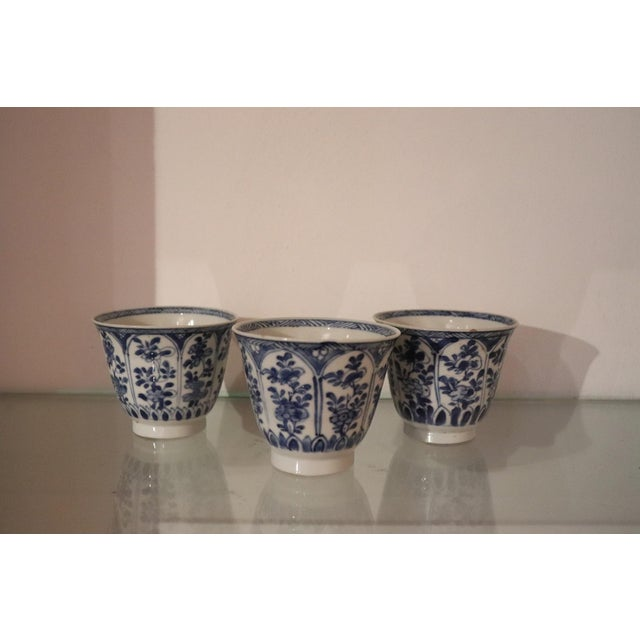 19th century set of three porcelain china cups finely decorated in blue color. Mark under the base. Coming from a...