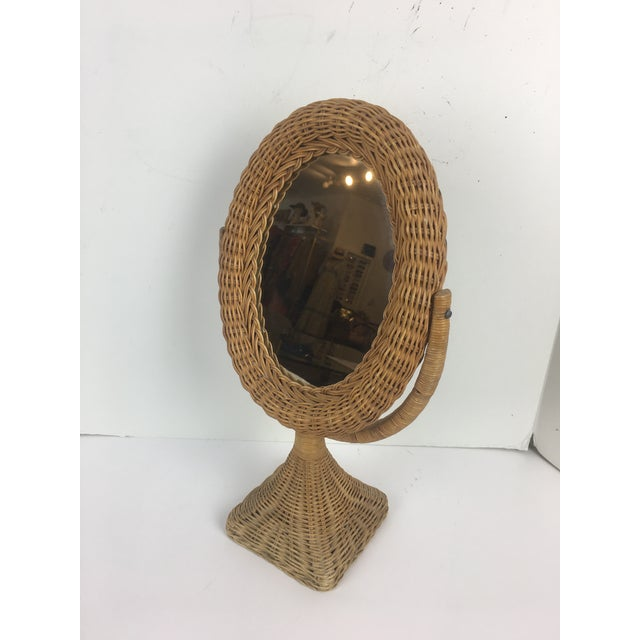 Vintage Wicket rattan swivel table mirror. Great for any room. It swivels, has a mirror, on only one side. Good vintage...