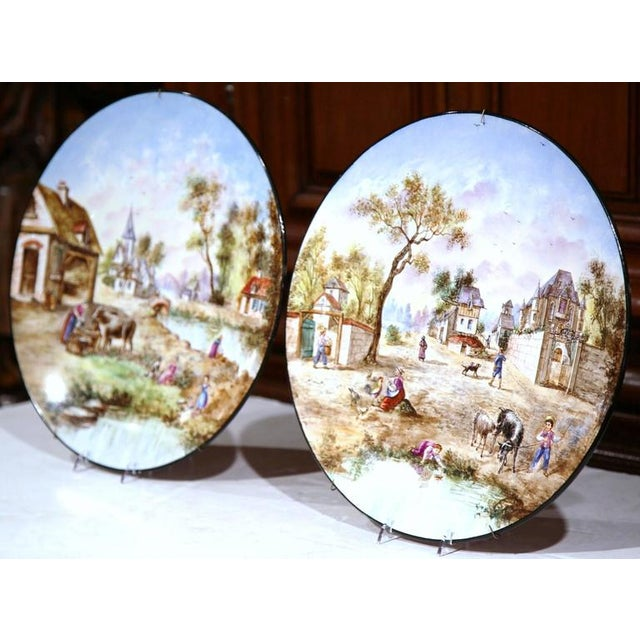Decorate your kitchen wall with this pair of large, colorful chargers from France. Sculpted circa 1900, the hand-painted...