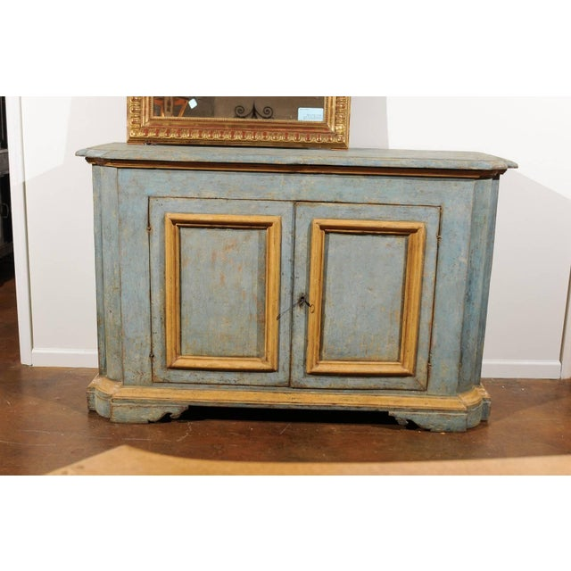 An Italian early 19th century painted wood two-door buffet from Florence. This painted buffet was born in Tuscany in the...