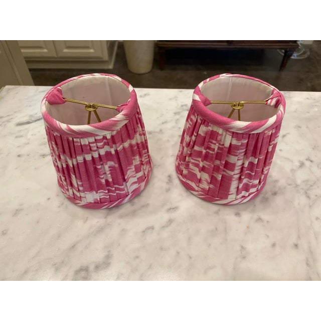 This is a pair of custom pink ikat shades that are meant to fit right over the light bulb making them perfect for a...