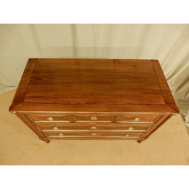 Lovely 19th c 3 drawer walnut French Louis XVI style commode. drawers have burl walnut veneer fronts with brass trim....