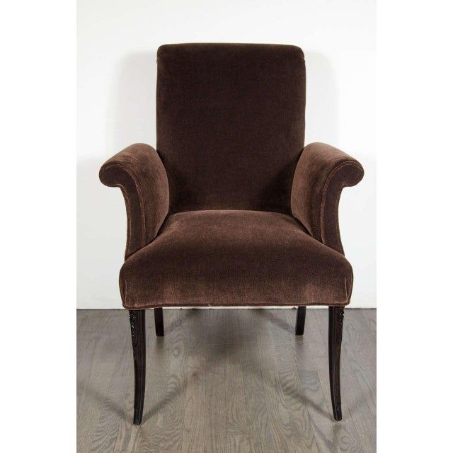 This elegant 1940's Hollywood occasional chair by Grosfeld House features scroll detailing on the arms and back, the side...