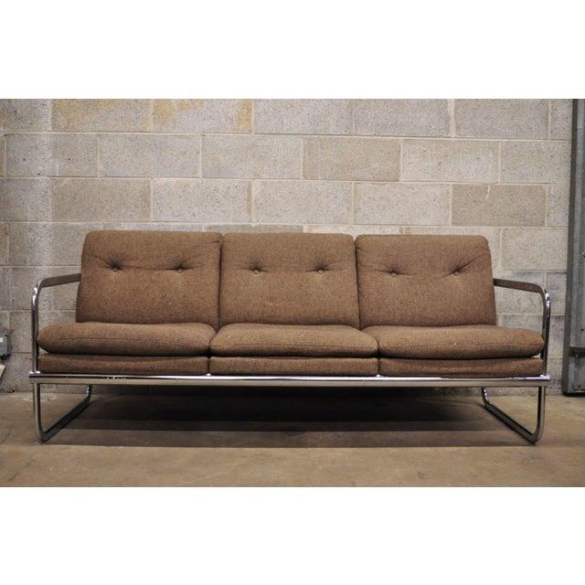 Mid Century Modern Chrome Frame Milo Baughman Style Sofa by United Chair. Item features chrome tubular rear support,...