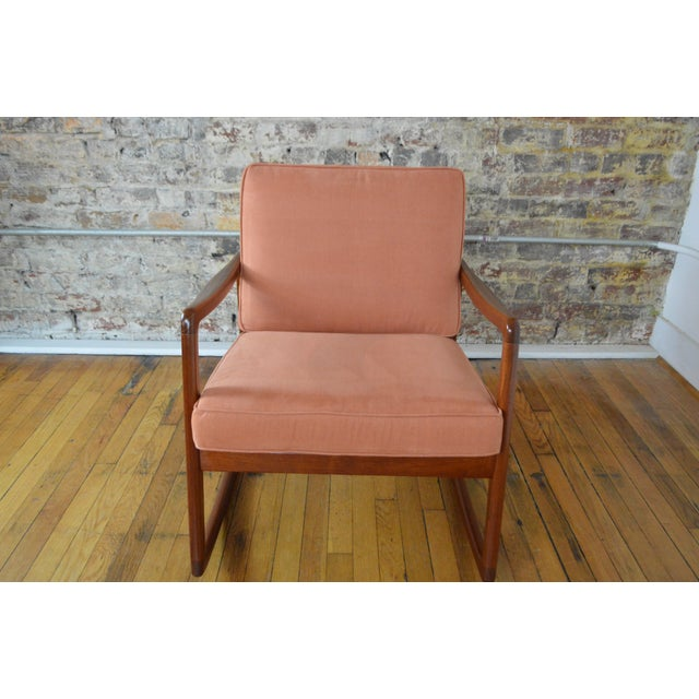 Beautifully crafted compact rocking chair by one of the Danish modern greats. Constructed of rich solid teak this chair...