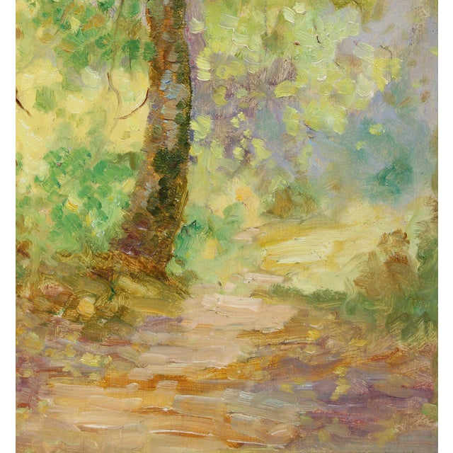 This circa 1900-1930s oil on wood panel pale landscape with trees along a forest path is by Scottish-American artist...