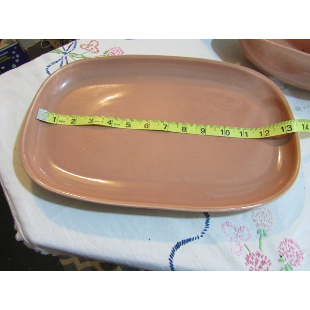 Lovely lines on these 2 vintage pieces, coral color, no damage, marked Russel Wright USA